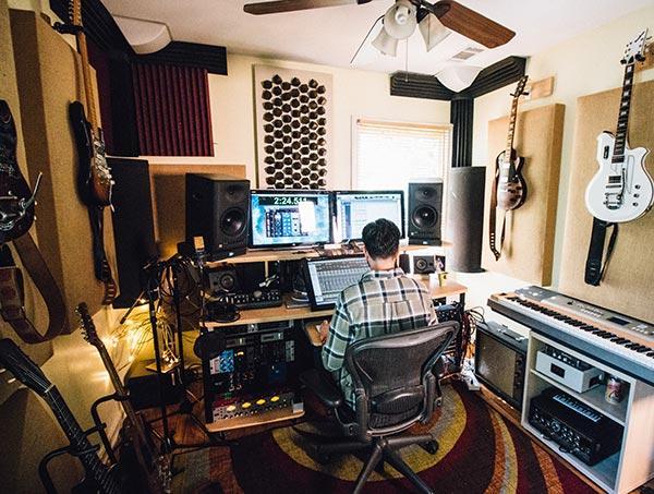 Audio engineer in his home studio
