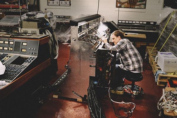 Rich Hunt repairs a vintage Neve console