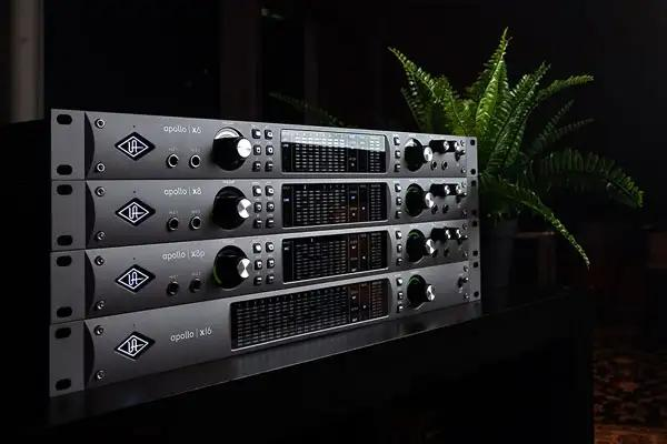 Stack of all four Universal Audio Apollo X units angled with plant in background